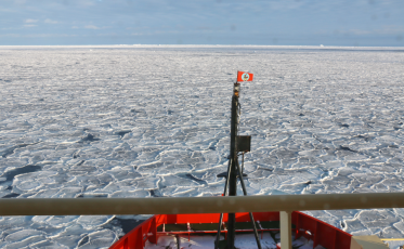 """Icebreaker NB Palmer driving through a field of new """"pancake"""" sea ice in Antarctica."""
