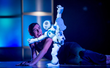 """""""Planet of the Humans: The Leap to the Top"""" opened with an excerpt from Blanca Li's hit show """"Robot,"""" where the organic and mechanic perform a playful pas de deux."""